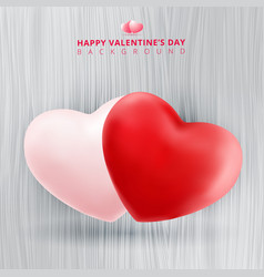 realistic twin pink and red hearts on wooden vector image