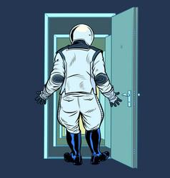 Modern astronaut stands in front an open door vector
