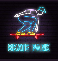 Neon skate park sign on brick wall background vector