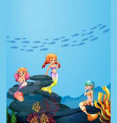 three mermaids swimming under the ocean vector image