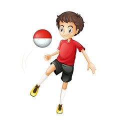 A boy using the ball with the Monaco flag vector image
