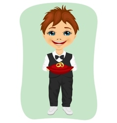 Little boy holding wedding rings on cushion vector image vector image