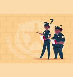 Two african american police women holding boxes vector