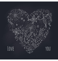 Floral heart on blackboard vector image