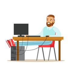 Smiling bearded man working on a computer at his vector