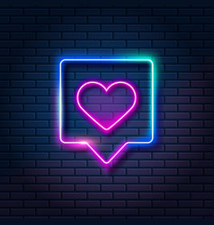Neon heart in speech bubble on dark brick wall vector