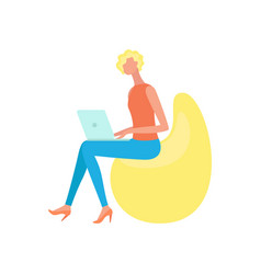 woman sitting on bean chair and working on laptop vector image
