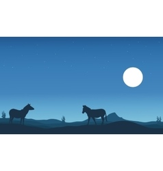 Two zebra silhouettes in hills vector image