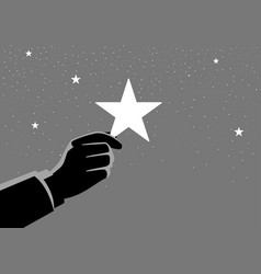 Businessman hand picking up a star vector