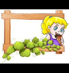 A frame with a young girl eating an icecream vector image