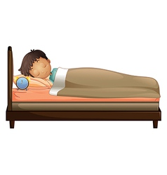 A boy sleeping with an alarm clock vector image