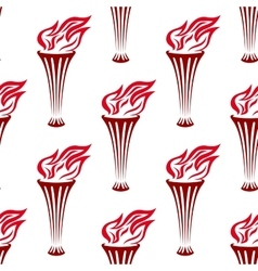 Seamless pattern of a red flaming torches vector image