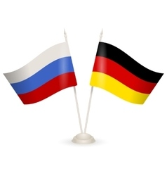 Table stand with flags of Russia and Germany vector image vector image