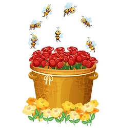A basket of red roses with bees vector image