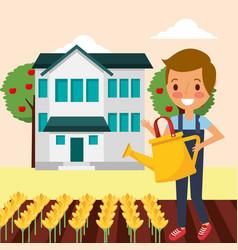 cute gardener boy watering flowers in the house vector image