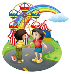 Boys handshaking in front of the carnival vector image vector image