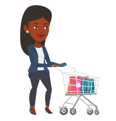 African woman walking with shopping trolley vector
