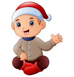 cute little boy in santa hat waving vector image