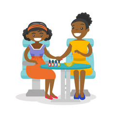 African woman getting manicure at beauty salon vector