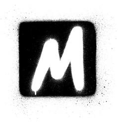 Graffiti m font sprayed in white over black square vector