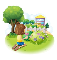 A girl picking flowers vector