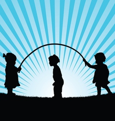 children play with rope silhouette vector image