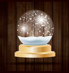 Christmas crystal ball with snow on wooden vector