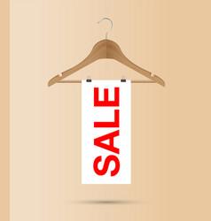 sale sign on a wooden hanger vector image