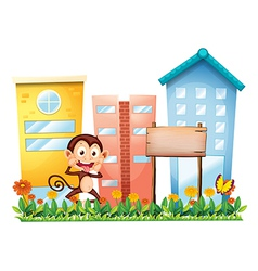 A monkey in the garden with a wooden signboard vector image vector image