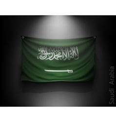 Waving flag Saudi Arabia on a dark wall vector