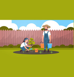 Couple farmers planting young tree man holding vector