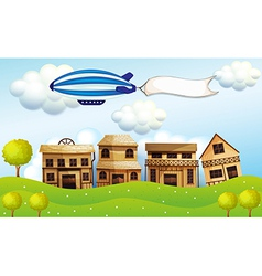 An airship above the neighborhood with a banner vector image