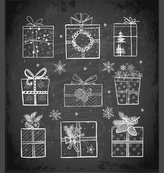 christmas gift boxes on blackboard background vector image