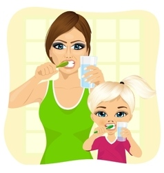 Mother and daughter brushing teeth vector