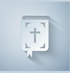 paper cut bible book icon isolated on grey vector image