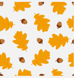 Autumn seamless pattern with oak leaves and acorns vector