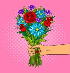 Hand with flowers pop art vector
