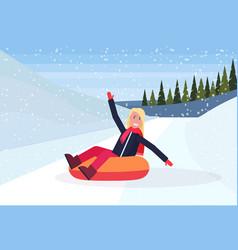 happy woman sledding on snow rubber tube winter vector image