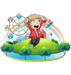 A happy boy at the carnival vector image