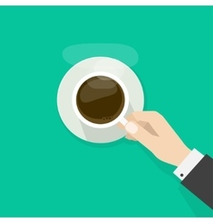 Hand holding hot coffee cup with steam on plate vector