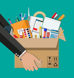 office accessories in cardboard box in hand vector image