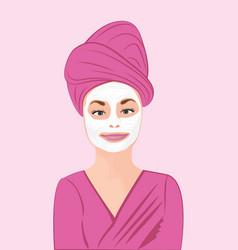 a girl applying a cream onto her face vector image