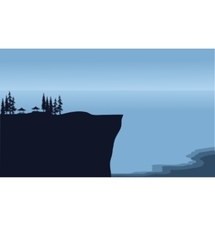 Silhouette of cliff in beach scenery vector
