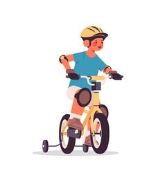 little boy in helmet riding bike childhood concept vector image