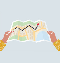hands holding paper map folded map in hands of vector image