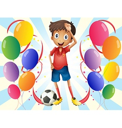A soccer player in the middle of the balloons vector image vector image