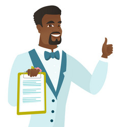 groom holding clipboard and giving thumb up vector image