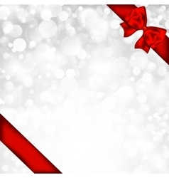 Shiny silver background with red bow vector image