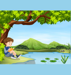 boy reading book by the pond vector image