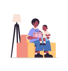African american father holding gift box for son vector